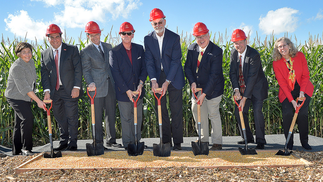 CALS administration and leadership team posing with shovels at the ground-breaking ceremony.